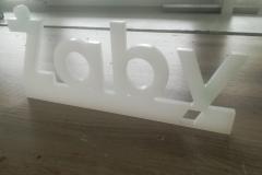 napis wyfrezowany zplexi mlecznej ogr. 10mm.